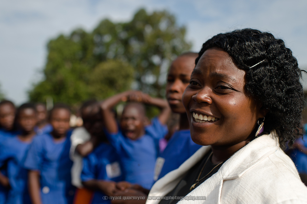 Sarah Angwech, a teacher at Agwait Primary School near Tororo in Eastern Uganda, speaking to both girls and boys about menstrual hygiene on 1 August 2014. The school participates in a Menstrual Health Management program supported by Plan International.