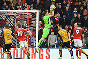 Bristol City goalkeeper Fabian Giefer (33) (on loan from Schalke 04) jumps for the ball during the EFL Sky Bet Championship match between Nottingham Forest and Bristol City at the City Ground, Nottingham, England on 21 January 2017. Photo by Jon Hobley.