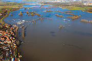 Nederland, Gelderland, Hattem, 20-01-2011; de IJssel bij hoogwater bij Hattem, de Hoenwaard is geheel onder water komen te staan. In de achtergrond Zwolle, met spoorbruggen en Hanzelijn..The high water of the river IJssel has flooded the flood plains Hoenwaard. Three bridges near Zwolle in the background..luchtfoto (toeslag), aerial photo (additional fee required).copyright foto/photo Siebe Swart