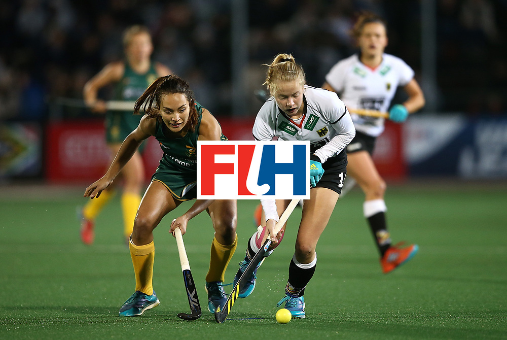 JOHANNESBURG, SOUTH AFRICA - JULY 18:  Naomi Heyn of Germany battles with Quanita Bobbs of South Africa during day 6 of the FIH Hockey World League Women's Semi Finals quarter final match between Germany and South Africa at Wits Univesity on July 18, 2017 in Johannesburg, South Africa.  (Photo by Jan Kruger/Getty Images for FIH)