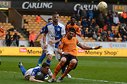 Blackburn Rovers midfielder Darragh Lenihan clears Wolverhampton Wanderers defender Danny Batth shot during the Sky Bet Championship match between Wolverhampton Wanderers and Blackburn Rovers at Molineux, Wolverhampton, England on 9 April 2016. Photo by Alan Franklin.