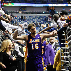 February 5, 2011; New Orleans, LA, USA; Los Angeles Lakers power forward Pau Gasol (16) celebrates with fans following a win over the New Orleans Hornets at the New Orleans Arena. The Lakers defeated the Hornets 101-95.  Mandatory Credit: Derick E. Hingle