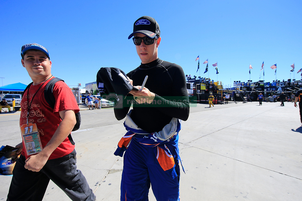 September 14, 2018 - Las Vegas, NV, U.S. - LAS VEGAS, NV - SEPTEMBER 14: Brad Keselowski (2) Team Penske Ford Fusion signs an autograph during practice for the South Point 400 Monster Energy NASCAR Cup Series Playoff Race on September 14, 2018 at Las Vegas Motor Speedway in Las Vegas, NV. (Photo by David Griffin/Icon Sportswire) (Credit Image: © David Griffin/Icon SMI via ZUMA Press)