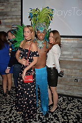 Left to right, LAURA PRADELSKA, samba dancer and STEPHANIE HOPPE at the OMEGA 100 days to Rio Olympics VIP Dinner at Sushi Samba, Heron Tower, 110 Bishopsgate, City of London on 27th April 2016.
