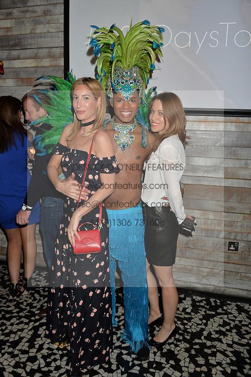 Left to right, LAURA PRADELSKA, samba dancer and STEPHANIE HOPPE at the OMEGA 100 days to Rio Olympics VIP Dinner at Sushi Samba, Heron Tower, 110 Bishopsgate, City of London on 27th April 2016.