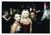 Natalie Raitano, Pamela Anderson and friend.  Back lot party.  California.<br />