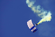 A sky diver with the U.S. Air Force Academy's Wings of Blue Parachute Team colors the sky during a jump at the Air Show at Hill Air Force base in Utah, June 6, 2009.