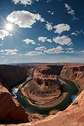 The sun creates a star shape above Horseshoe Bend outside of Page, Arizona. Missoula Photographer