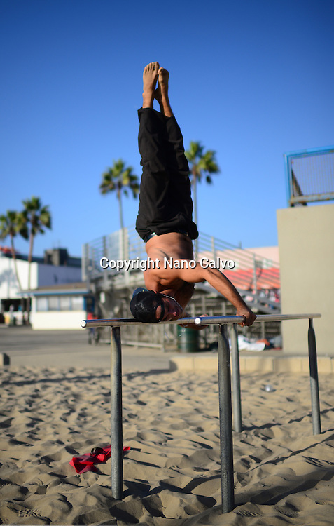 Carlo, chilean young man training in Venice Beach Calisthenics park, California.