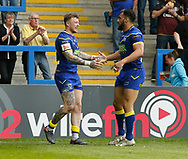 Josh Charnley (L) of Warrington Wolves celebrates scoring his try with team mate Ryan Atkins (R) against Bradford Bulls during the Ladbrokes Challenge Cup match at the Halliwell Jones Stadium, Warrington<br /> Picture by Stephen Gaunt/Focus Images Ltd +447904 833202<br /> 21/04/2018