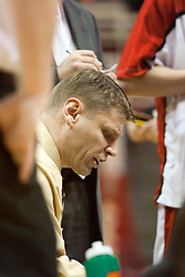 15 January 2005<br /> <br /> Coach Porter Moser addresses his team during a time out as the Illinois State University Redbirds keep the Drake Bulldogs on a leash as they pull ahead in the 2nd half for a74 - 61 Victory.  Redbird Arena, Illinois State University, Normal IL