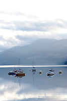 Loch Tay in Scotland shot from Kenmore. With boats moored on lake
