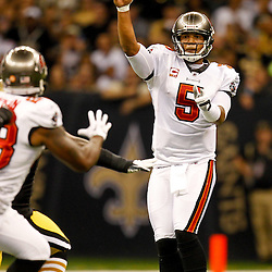 November 6, 2011; New Orleans, LA, USA; Tampa Bay Buccaneers quarterback Josh Freeman (5) dumps off a pass to running back Kregg Lumpkin (28) during the second quarter of a game against the New Orleans Saints at the Mercedes-Benz Superdome. Mandatory Credit: Derick E. Hingle-US PRESSWIRE