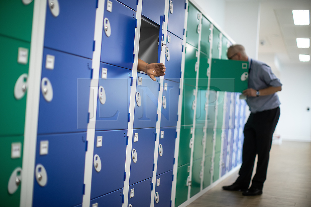 © Licensed to London News Pictures. 10/07/2019. Manchester, UK. Examination tools including lifelike human body parts are arranged in storage lockers at the new facility. General Medical Council (GMC) staff prepare for the opening of the regulator's new test facility in central Manchester. The £2.5m clinical assessment centre in the city's Spinningfields district will assess the skills of overseas-trained doctors who want to work in the UK. Once it opens in early August, more than 1,000 doctors per month will undergo a series of practical tests to show they have the skills required for a licence to practise medicine in the UK. It will replace the GMC's existing test centre, which has a more limited capacity. Photo credit: Joel Goodman/LNP