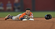 Houston Astros second basemen Jose Altuve (27) reaches back to touch second after falling rounding second base after hitting a double against the Kansas City Royals during the sixth inning at Kauffman Stadium.