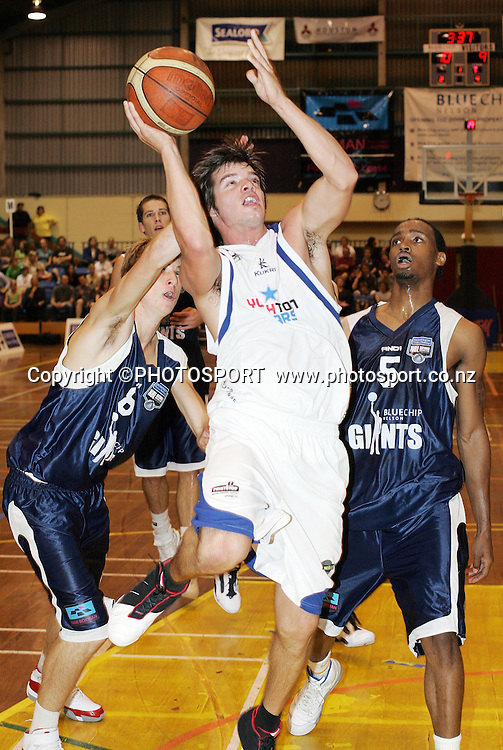 Auckland Stars guard Josh Clark splits the defense of Nelson Giants guards Nico Ritschny and Josh Pace during the NBL basketball match between the Blue Chip Nelson Giants and the Youth Town Auckland Stars at the Trafalgar Centre, Nelson, New Zealand. Auckland won the game 81-79. Photo: Evan Barnes/Nelson Mail/PHOTOSPORT *** Local Caption ***