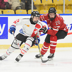 WHITBY, - Dec 13, 2015 -  WJAC Game 2- Team Switzerland vs Team Canada East at the 2015 World Junior A Challenge at the Iroquois Park Recreation Complex, ON. Philipp Kurashev #23 of Team Switzerland battles for control with Matt Cairns #20 of Team Canada East during the second period.<br /> (Photo: Andy Corneau / OJHL Images)