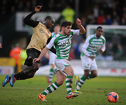 Yeovil Town's Joe Edwards challenges for the ball with Leyton Orient's Moses Odubajo. - Photo mandatory by-line: Harry Trump/JMP - Tel: Mobile: 07966 386802 04/01/2014 - SPORT - FOOTBALL - Yeovil - Huish Park - Yeovil Town v Leyton Orient - FA Cup - Third Round