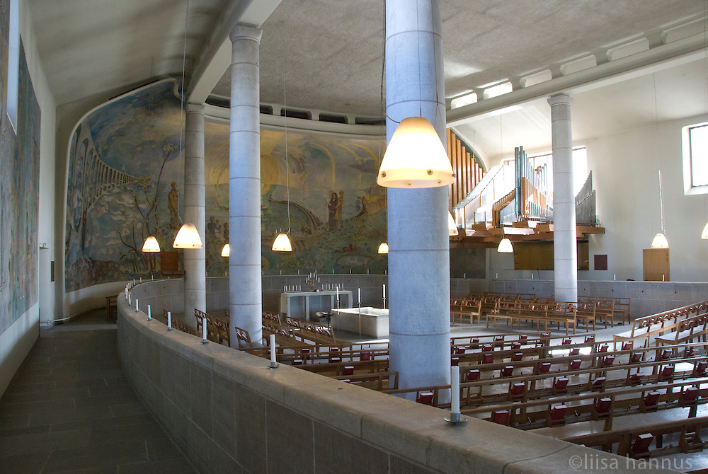 Spacious and filled with light, the Holy Cross Chapel at Skogskyrkogården, Stockholm, Sweden was designed to lift the spirits of mourners and to lighten the load of their grief. The chapel's large fresco Life-Death-Life was created by Sven Xet Erixson.
