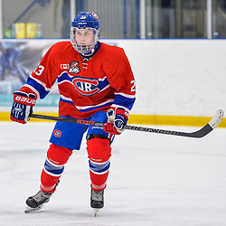OAKVILLE, ON  - FEB 23,  2018: Ontario Junior Hockey League game between the Oakville Blades and the Toronto Jr. Canadiens, Nolan Regan #23 of the Toronto Jr. Canadiens follows the play during the second period.<br /> (Photo by Ryan McCullough / OJHL Images)