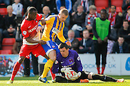 Moses Odubajo &amp; goalkeeper Eldin Jakupovic of Leyton Orient and Jake Bidwell of Brentford during the Sky Bet League 1 match at the Matchroom Stadium, London<br /> Picture by Mark D Fuller/Focus Images Ltd +44 7774 216216<br /> 15/03/2014