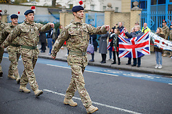 © licensed to London News Pictures. London, UK 27/11/2013. More than 180 soldiers of 1st Battalion The Royal Regiment of Fusiliers (1RRF) marking their return from Afghanistan by holding a homecoming parade in Balham, south London on Wednesday, 27 November 2013. Photo credit: Tolga Akmen/LNP