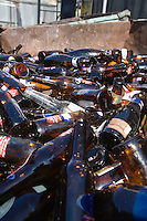 Pile of glass bottles in bin