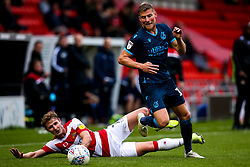 Alfie Kilgour of Bristol Rovers goes past Kieran Sadlier of Doncaster Rovers - Mandatory by-line: Robbie Stephenson/JMP - 19/10/2019 - FOOTBALL - The Keepmoat Stadium - Doncaster, England - Doncaster Rovers v Bristol Rovers - Sky Bet League One