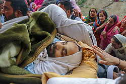 October 5, 2018 - Srinagar, Jammu And Kashmir, India - ( EDITOR'S NOTE, IMAGE DEPICTS DEATH)..Relatives and neighbors seen carrying the body of Nazir Ahmed Wani during his funeral in Srinagar..Suspected militants shot and killed two activists, who included Wani, affiliated with a pro-India Kashmiri political group in Habba Kadal Area Of srinagar main city, officials said. (Credit Image: © Idrees Abbas/SOPA Images via ZUMA Wire)