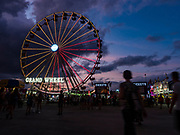 14 AUGUST 2019 - DES MOINES, IOWA: The Grand Wheel, a large ferris wheel ride, is the centerpiece of the Midway at the Iowa State Fair. The Iowa State Fair is one of the largest state fairs in the U.S. More than one million people usually visit the fair during its ten day run. The 2019 fair run from August 8 to 18.                PHOTO BY JACK KURTZ