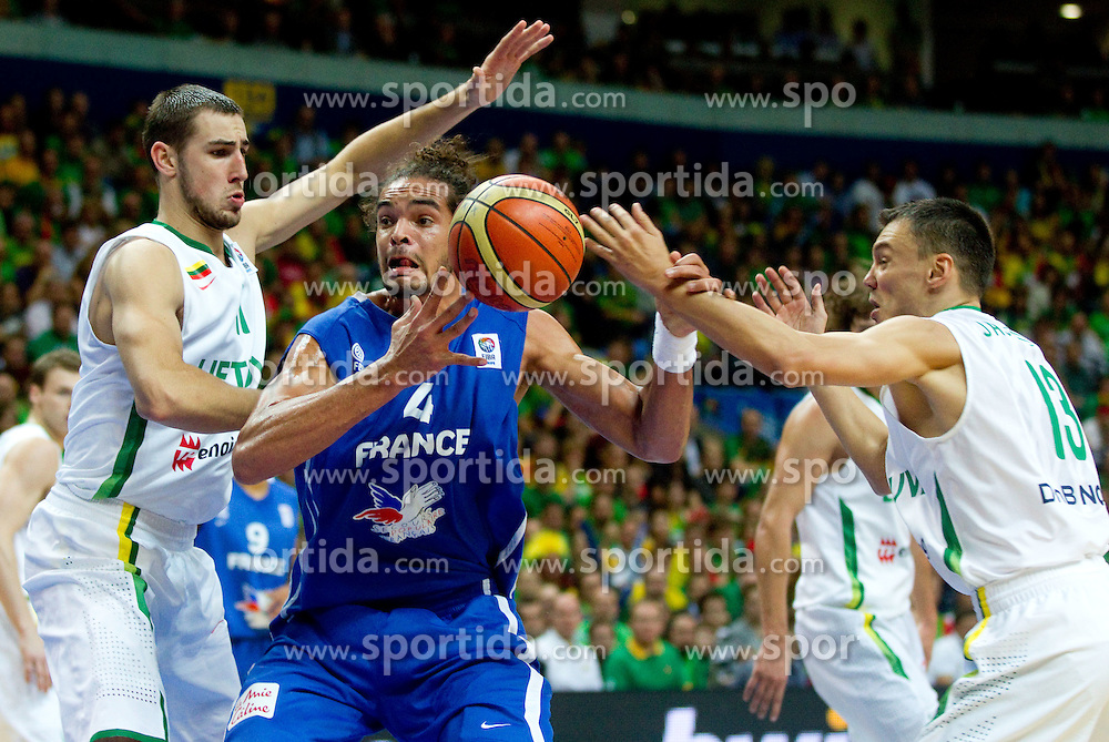 Joakim Noah of France between Jonas Valanciunas of Lithuania and Sarunas Jasikevicius of Lithuania during basketball game between National basketball teams of Lithuania and France at FIBA Europe Eurobasket Lithuania 2011, on September 9, 2011, in Siemens Arena,  Vilnius, Lithuania.  (Photo by Vid Ponikvar / Sportida)