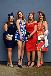 LIVERPOOL, ENGLAND - Thursday, April 6, 2017: [L-R] Sophie, 20 from Birmingham, wearing Lipsy, Gabby Pippard, 21 from the Wirral, wearing a blue and white rose print dress from Top Shop, Sammy, 21 from Birmingham wearing a dress from Boo Hoo and Charlotte, 21 from East Riding, wearing a dress from Zara during The Opening Day on Day One of the Aintree Grand National Festival 2017 at Aintree Racecourse. (Pic by David Rawcliffe/Propaganda)