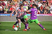 Sheffield Utd midfielder Kieran Dowell (8) taking on Bristol City defender Bailey Wright (5) during the EFL Sky Bet Championship match between Sheffield United and Bristol City at Bramall Lane, Sheffield, England on 30 March 2019.
