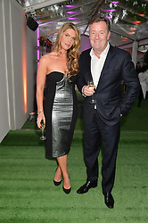 PIERS MORGAN and CELIA WALDEN at the Glamour Women of The Year Awards in Association with Next held in Berkeley Square Gardens, Berkeley Square, London on 3rd June 2014.