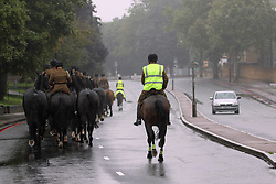 © Licensed to London News Pictures. 14/09/2013. Fifty horses from the King's Troop The Royal Artillery have paraded down to the Firepower, the Royal Artillery museum, at the Royal Arsenal in Woolwich.  They cantered in to Woolwich in heavy rain. Credit : Rob Powell/LNP