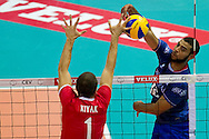 (R) Earvin Ngapeth from France attacks the ball against (L) Ulas Kiyak from Turkey during the 2013 CEV VELUX Volleyball European Championship match between France and Turkey at Ergo Arena in Gdansk on September 22, 2013.<br /> <br /> Poland, Gdansk, September 22, 2013<br /> <br /> Picture also available in RAW (NEF) or TIFF format on special request.<br /> <br /> For editorial use only. Any commercial or promotional use requires permission.<br /> <br /> Mandatory credit:<br /> Photo by © Adam Nurkiewicz / Mediasport