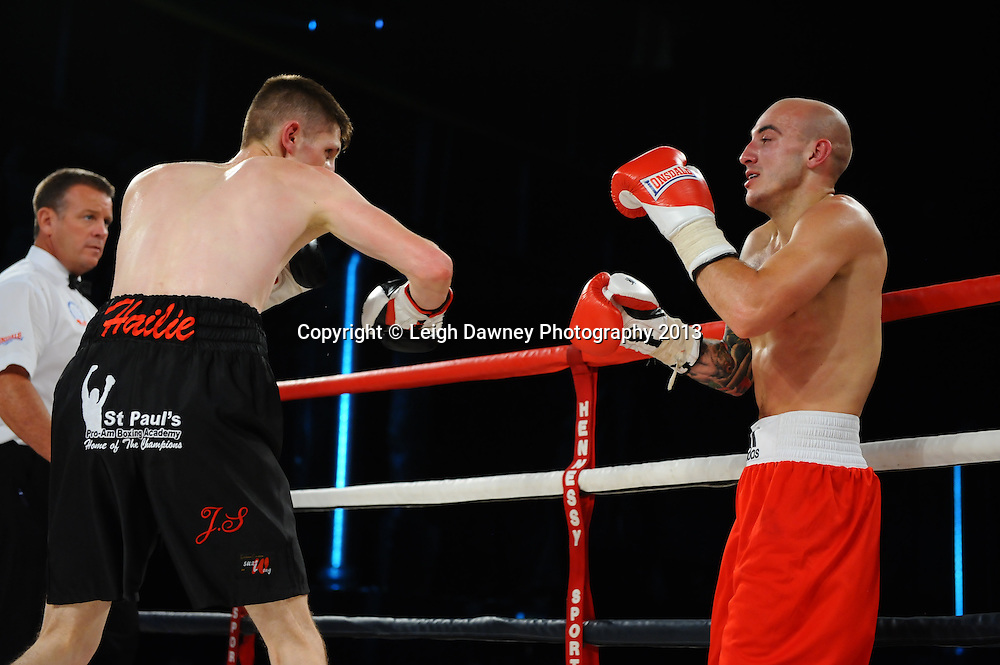 Jason Cunningham (black shorts) defeats Kyle King in a 4x3 Super Bantamweight contest on Saturday 14th September 2013 at the Magna Centre, Rotherham. Hennessy Sports. Self billing applies. © Credit: Leigh Dawney Photography.