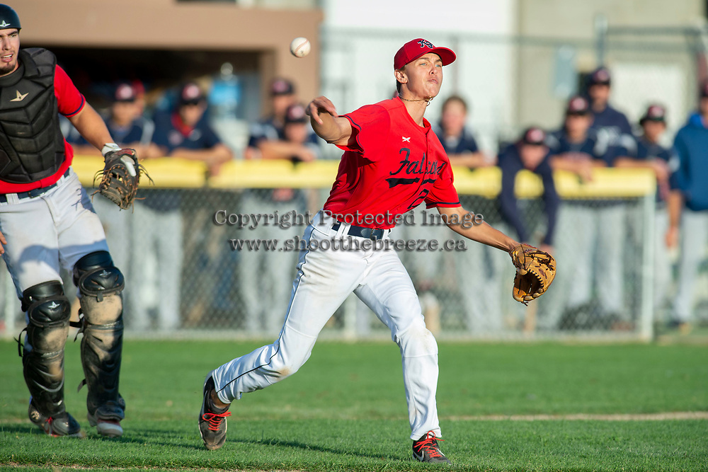 KELOWNA, BC - JULY 17:  Zach Jacobs #27 of the Kelowna Falcons throws to first after a bunt by the Wenatchee Applesox at Elks Stadium on July 17, 2019 in Kelowna, Canada. (Photo by Marissa Baecker/Shoot the Breeze)