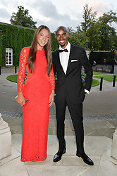 MO FARAH and his wife TANIA at 'A Night of Champions' an evening to raise funds for the Mo Farah Foundation held at The Hurlingham Club, London on 28th August 2014.