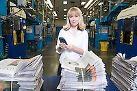 Woman working in newspaper factory portrait