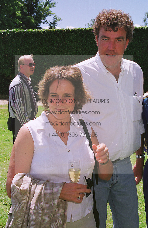 MR & MRS JEREMY CLARKSON he is the tv presenter, at a car rally in West Sussex on 20th June 1999.MTM 58