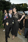 Stephen Jones and Erin O'Connor, Stephen Jones Summer Hat party to celebrate 25 years of Milllinery. Debenham House, 8 Addison Rd. Holland Park, London. 13 July 2006.  ONE TIME USE ONLY - DO NOT ARCHIVE  © Copyright Photograph by Dafydd Jones 66 Stockwell Park Rd. London SW9 0DA Tel 020 7733 0108 www.dafjones.com