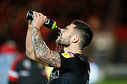Alex Mowatt of Barnsley F.C. splashes water over his face before the EFL Sky Bet League 1 match between Doncaster Rovers and Barnsley at the Keepmoat Stadium, Doncaster, England on 15 March 2019.