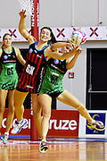 Tactix player Jess Moulds(L) and Fever player Khao Watts during their ANZ Championship Netball game between the Mainland Tactix v West Coast Fever. Marlborough Lines Stadium 2000, Blenheim, New Zealand. Sunday 12 April 2015. Copyright Photo: Chris Symes / www.photosport.co.nz