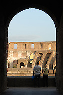 Tourists view the inside of the Colosseum from an upper level railing in Rome, Italy. (Photo by Phelan M. Ebenhack)