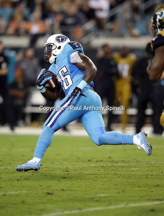 Tennessee Titans running back Antonio Andrews (26) runs the ball during the 2015 week 11 regular season NFL football game against the Jacksonville Jaguars on Thursday, Nov. 19, 2015 in Jacksonville, Fla. The Jaguars won the game 19-13. (©Paul Anthony Spinelli)