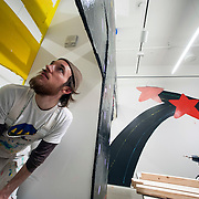 "March 10, 2012 - New York, NY : Justin Waldron contemplates the placement of support beams as he helps install Misaki Kawai's ""Love from Mt. Pom Pom"" at the Children's Museum of the Arts in the south village on Saturday, March 10. The show will be on exhibit from March 14 until June 10. CREDIT: Karsten Moran for The New York Times"