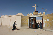Christians outside St Tawdros (St Theodore's) Coptic Orthodox Christian Monastery, Luxor, Nile Valley, Egypt. The Copts are an ethno-religious group in North Africa and the Middle East, mainly in the area of modern Egypt, where they are the largest Christian denomination. Christianity was the religion of the vast majority of Egyptians from 400–800 A.D. and the majority after the Muslim conquest until the mid-10th century. Today, there are an extimated 9-15m Copts in Egypt.