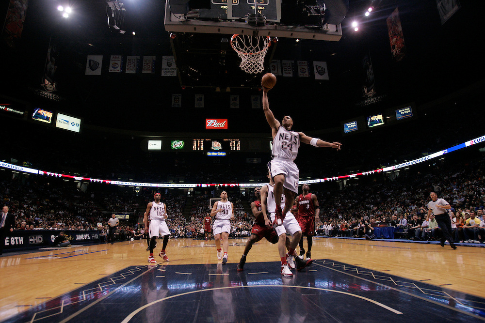 Richard Jefferson of the New Jersey Nets dunks against the Miami Heat at The Continental Airlines Arena in East Rutherford New Jersey. Sunday 14 May 2006 (Andrew Gombert for the New York Times)