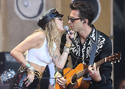 © Licensed to London News Pictures. 30/06/2019. Glastonbury , UK. Miley Cyrus performs with Mark Ronson on the Pyramid stage on the last day of the Glastonbury Festival in Somerset. Photo credit: Jason Bryant/LNP